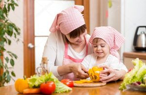 depositphotos_47627861-stock-photo-mother-and-kid-girl-preparing